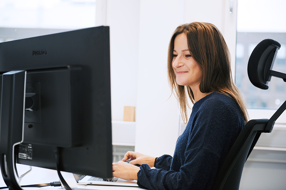 Certificate lifecycle management - woman in front of computer