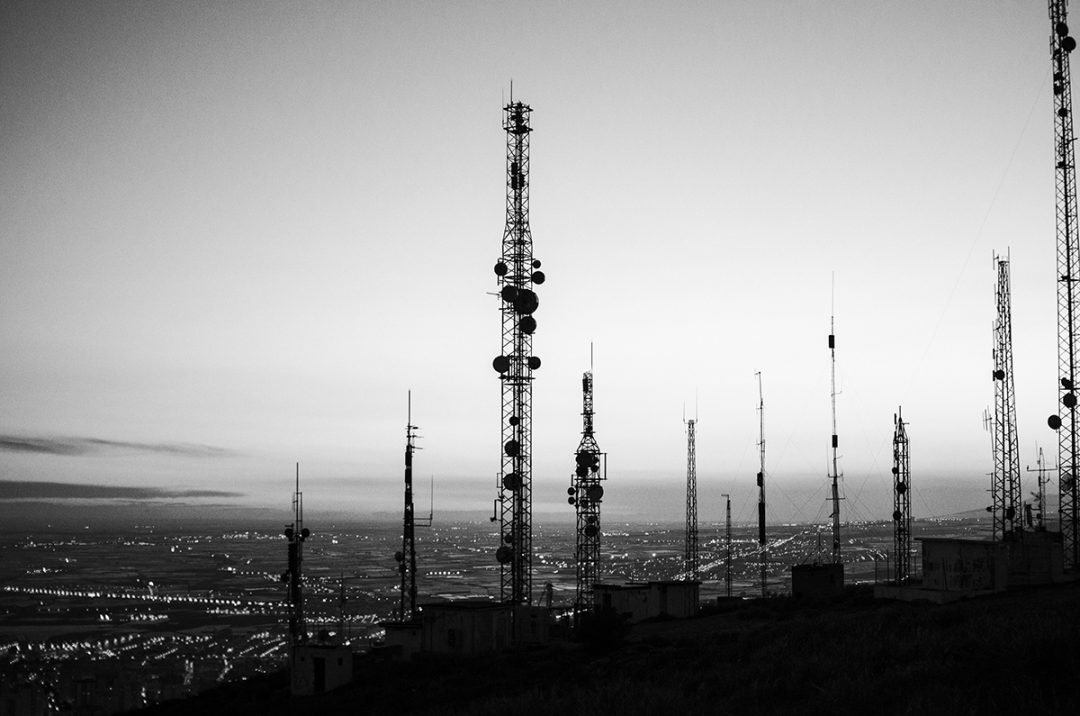 communication tower. cell, radio and television antennas on top